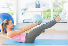 Sporty young woman stretching body in fitness studio Stock Photography