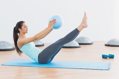 Sporty young woman stretching body in fitness studio Royalty Free Stock Image
