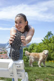 Sporty young woman stretching leg outdoor Stock Image