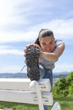 Sporty young woman stretching leg outdoor Stock Images