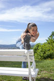 Sporty young woman stretching leg outdoor Royalty Free Stock Photos