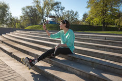 Sporty young woman taking selfie, using a digital tablet Royalty Free Stock Photos