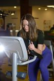 Sporty young woman training on exercise bike Stock Photography