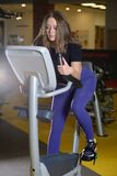 Sporty young woman training on exercise bike Royalty Free Stock Photos
