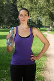 Sporty young woman with water bottle Royalty Free Stock Images