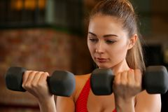 Sporty young woman work out biceps Royalty Free Stock Photo