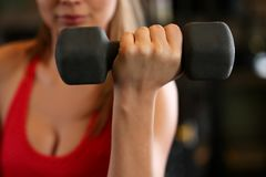 Sporty young woman work out biceps Royalty Free Stock Image