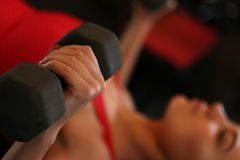 Sporty young woman work out chest Royalty Free Stock Images