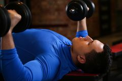 Sporty young woman work out chest Royalty Free Stock Photos