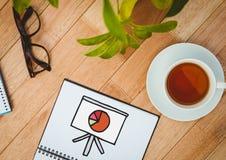 Sporządza mapę doodle na notepad obok herbaty, rośliny i szkieł, Fotografia Stock