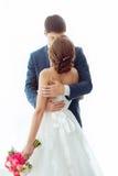 Sposa e sposo nella stanza molto luminosa a casa Fotografia Stock Libera da Diritti