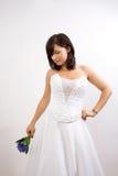 Sposa in un vestito da cerimonia nuziale Fotografie Stock