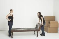 Spostamento della mobilia pesante Immagini Stock Libere da Diritti