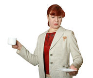 Spot from coffee on clothes. The young woman looks at a spot about coffee on the suit Royalty Free Stock Images
