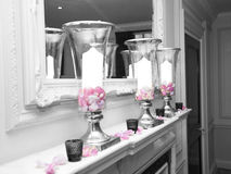 Candle Vases. Spot colour candles in vases in black & White Stock Photo