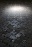 Spot light on an ancient floor of tiles Royalty Free Stock Photography