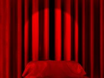 Spot light on curtains. Spot light pointing to a blanket or a box covered with silk on a stage Royalty Free Stock Photo