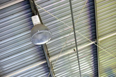 Spot light in industrial plant ceiling Stock Photography