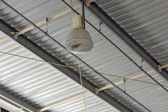 Spot light in industrial plant ceiling Stock Images