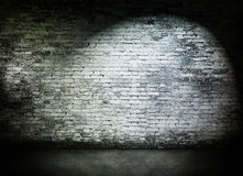 Spot light on old brick wall Royalty Free Stock Photos