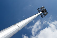 Spot light pole with blue sky in the stadium Royalty Free Stock Photos