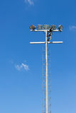 Spot light pole with blue sky in the stadium Royalty Free Stock Images