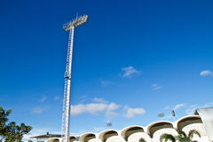 The spot light posts in the stadium. The light posts in the stadium in daytime.Some day in the summer of Thailand is so nice sky Royalty Free Stock Photography