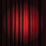 Red curtain. Spot light on a red curtain stage Stock Image