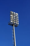 Spot-light tower. On blue sky Royalty Free Stock Photos