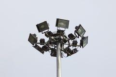 Spot-light tower on blue sky. Royalty Free Stock Photography