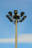 Spot-light tower. Blue sky background stock image