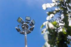 Spot-light tower on blue sky background. Multiple sport light tower on blue sky background Royalty Free Stock Photography