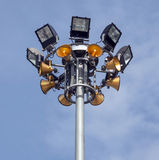 Spot-Light Tower With Gold Color Speakers. Over Beautiful Sky and Cloud Background Stock Image