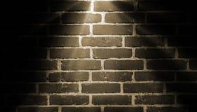 Spot lighting background yellow. Spot light yellow on brick wall royalty free stock images