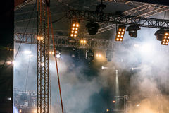 Spot lightning system mounted on stage for illumination during c. Spot lightning system mounted on outdoor stage for illumination during concert stock photography