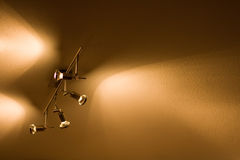 Spot lights. Shining on the ceiling stock images