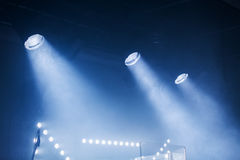 Spot lights with blue rays in the dark Royalty Free Stock Image