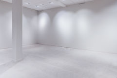 Spot lights and empty white wall as copy space. Spot lights and blank white wall as copy space, empty department store or warehouse Royalty Free Stock Images