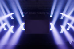 Spot lights Stage With Blank Screen in the Middle. Spot lights on a Empty Stage With Blank Screen in the Middle before a Big Concert Stock Photography