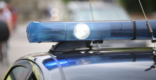 spot ljus och slösa blinkande ljus av polisbilen Arkivbilder