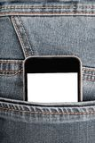 Spot omhoog met moderne smartphone in jeanszak royalty-vrije stock foto's