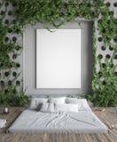 Spot op affichekader in hipsterslaapkamer Bed in vloer en klimop op concrete muren Royalty-vrije Stock Afbeelding