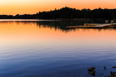 Spot Pond Sunset. Spot Pond, part of the larger Middlesex Fells Reservation straddling Malden, Medford, Stoneham, Melrose, and Winchester, Massachusetts, is Royalty Free Stock Images