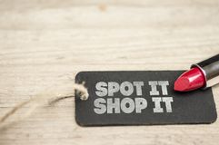 Spot it Shop it slogan. Red lipstick and tag writing spot it shop it Stock Images