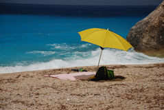 A spot under the sun. A spot under umbrella on a beach with beautiful sea color Stock Images