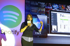 Spotify launch in Taiwan. On Sep. 24, 2013. Asian supervisor Sunita Kaur explain the interface Stock Image