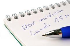 Spotkanie przy lekarką pisać w francuskim zdjęcie royalty free