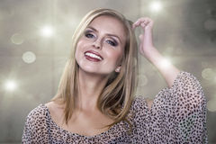 Spotless young blond woman smiles at you Royalty Free Stock Images