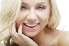 Spotless young blond woman Stock Images