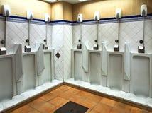 Antique Porcelain Urinals in Barcelona Public Toilet, Spain. Spotlessly clean antique early 20th century porcelain urinals in the Pueblo Espana mens public stock photos
